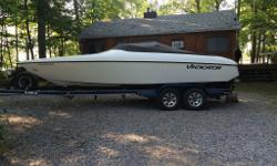 24 foot powerboat Vindicator deep V 496 efi 8.1 liter mercury engine . Bravo performance drive . silent choice exhaust. Cuddy cabin. Stereo , full gauge package fold away seat for stand up driving. custom cover . Custom made Eagle top of the line trailer