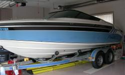 Doral Phazar, 23' sport cuddy cruiser with Merc 7.4L, bravo 1 leg, stainless steel prop, convert & storage tops, pump out head, depth sounder, stereo, trim tabs, halon fire suppression system, thru hull exhaust & Calkins tandem axle trailer with brakes.