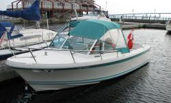 Displacement: 3900 lbs CONSTRUCTION: Single piece balsa cored, hand lay up fiberglass construction. Smoke white hull. Heavy duty vinyl rub rail with rope inlay at hull deck joint. DECK and INTERIOR: Diamond non-skid pattern on all flat surfaces. Stainless