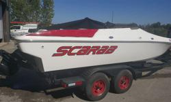Scarab 22 well maintained less then 300hrs on the engine 7.4l mercruisers stainless prop 23p. Comes with dual axle trailer all leds lights.
