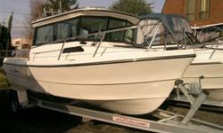 Great trailerable combination boat for fishing and cruising. This hardtop model has the reverse rake windshield for greater interior roominess, plus a mini galley with stove and small dinette. Add hydraulic steering, trim tabs, Jump seats, Foot rest,
