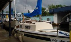 24 ft shark sailboat made by Hinterholler that comes equipped with a 5 hp mercury outboard engine, one mail sail, a jib and a genoa. The Cabin sleeps 4. In good condition and has been in the water every summer.