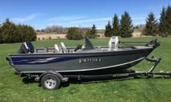 16.5' LUND 1660 CLASSIC SS 2004, MINT CONDITION, Evinrude E-tec 50hp, minn-kota, Lawrence fish finder, two batteries, live-well, ez-loader trailer with spare tire and canvas cover. Very safe and reliable fishing boat., $12700.