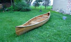 This is a handcrafted Canoe. There are no paddles with it. It could use another coat of spar to the outside as it has been in the water. onthewing