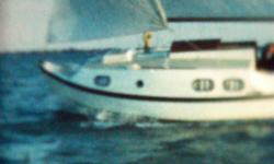 Shallow draft(2.25 ft.) with Bilge Keels & Skeg. Tandem AxleTrailor included. 10 hp. Volvo Penta Marine Diesel, model MD1B.10 gal. fuel tank. Mast configured to hinge at deck to easily lower. Full sail set.(Main, Storm Jib, Self furling jib & genoa.
