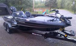 2014 Triton 19 XS Tournament Pkg with 225 Pro XS Optimax, Upgrades;1198 (in dash) and 889 Humminbird graphs with SI/DI, Hotfoot, 101 MinnKota Fortrex 36 V, 4 Bank built-in charger, Dual console (passenger side is easy removed), gas charger pro seat plus