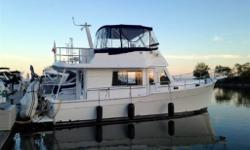 The Mainship 35 Trawler is a stylish cruiser with classic trawler lines and a good turn of speed.She is a very roomy boat inside thanks to her 14-foot, 2-inch beam. Both staterooms include double births as well as a separate stall shower in the head.