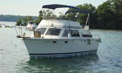 SOLD      THE CLASSIC 1976 TROJAN 36 TRI FLY,    built on a solid fiberglass hull with cored decks.   The raised forward pilot station is located amidship for greater manoverability,  the aft deck with seating for six is located over the aft cabin,