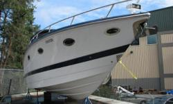KELOWNA One of the Largest Boats of it's Kind, Complete with TONS of Amenities! 16.2L 850 HP Stern Drive Mercruiser Magnum Engine, 113 Engine Hours, Cabin with Lounge, Midship Berth, Air Conditioning, Fridge/Freezer, Sink, Microwave, Single Burner