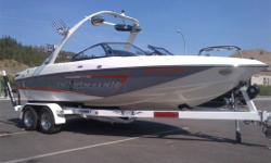 2009 Malibu VLX 21.5 ft boat. 163hrs. Loaded up with 4 ballasts, 2 amps, tower speakers, subwoofer, etc. Super Clean. White, Orange and grey. Comes with 2009 Extreme Tandem axle trailer. We'd be happy to answer any questions that you may have, your