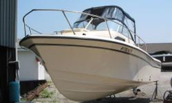 2006 GRADY WHITE 226 SEAFARER NOW OFFERED FOR SALE WALK AROUND $56,900.00 Clean fresh water local 226 Seafarer with Bimini top, visor and side curtains, Garmin 530 GPS, 225 hp Yamaha with low hours. STA N D A R D F E AT U R E S Safety Automatic bilge pump