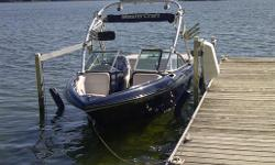 "2007 Wakeboard Edition. Navy blue hull with ""silver strike"" colour vinyl with navy blue accent. c/w Zero Flex tower, tower mirror and swivel board racks, forward facing tower mounted lights, am/fm/cd stereo with mp3 adapter, driver side remote, heater,"