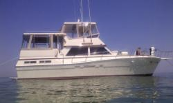1989 Viking 44' Motor Yacht with Twin Diesel engines, this is an ocean boat in Lake Erie, Diesel power, twin, hard top options, Full beam to beam aft cabin, Huge forward cabin, Loaded and very clean Here's the last yacht you will need