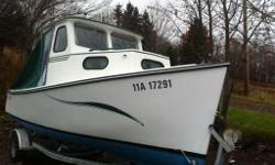 18' Rosborough with 70hp Johnson out board. (1986 2 stroke) Boat runs great. Fibreglass hull. Many new upgrades. New house, all new electrical, new windows. EZ load trailer. Marine radio, Fish finder, am/fm cd stereo, compact porta pottie, brand new
